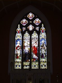 Stained Glass Windows behind the altar in Bruff Church